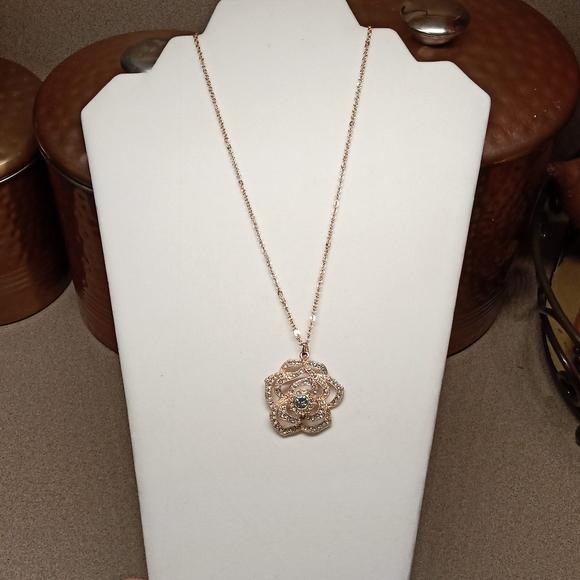 Faux-diamond rose necklace.